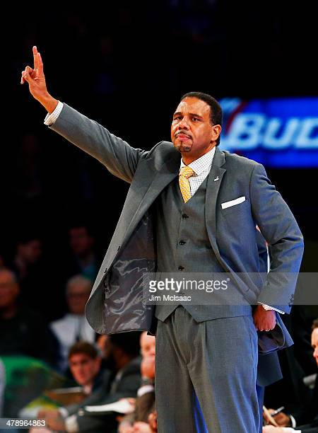 Head coach Ed Cooley of the Providence Friars signals in the first half against the Creighton Bluejays during the Championship game of the 2014 Men's...