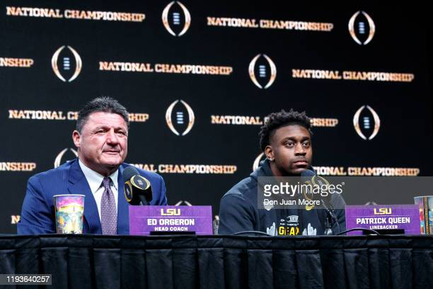 Head Coach Ed Orgeron and Linebacker Patrick Queen of the LSU Tigers talk with the media during the press conference after the College Football...