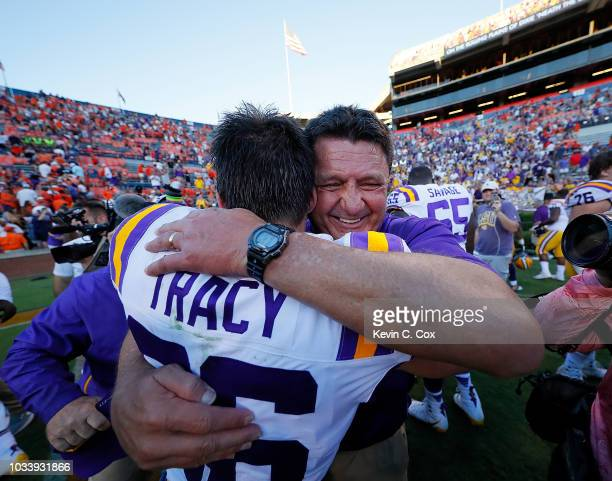 Head coach Ed Orgeron hugs Cole Tracy of the LSU Tigers after he kicked the gamewinning field goal in their 2221 win over the Auburn Tigers at...
