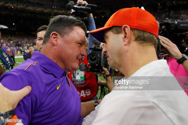 Head coach Ed Orgeron of the LSU Tigers and head coach Dabo Swinney congratulate each other after the 42-25 win in the College Football Playoff...