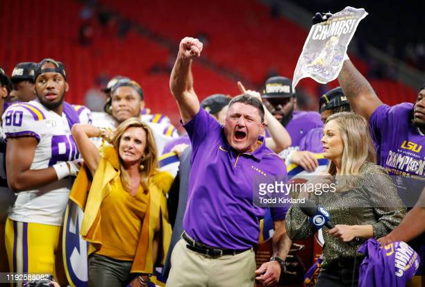 Head coach Ed Orgeron of the LSU Tigers celebrates defeating the Georgia Bulldogs 3710 to win the SEC Championship game at MercedesBenz Stadium on...