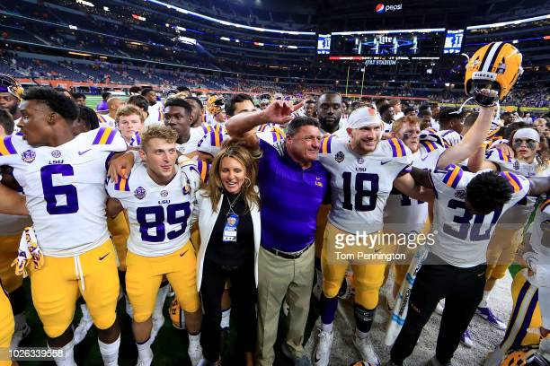 Head coach Ed Orgeron of the LSU Tigers celebrates with his team after the LSU Tigers beat the Miami Hurricanes 3317 in The AdvoCare Classic at ATT...