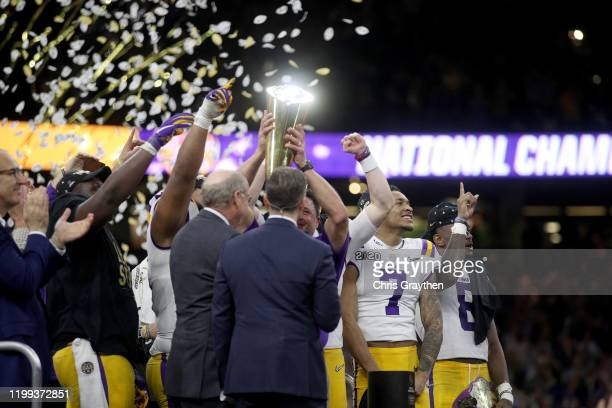 Head coach Ed Orgeron of the LSU Tigers celebrates with the trophy after defeating the Clemson Tigers 42-25 in the College Football Playoff National...