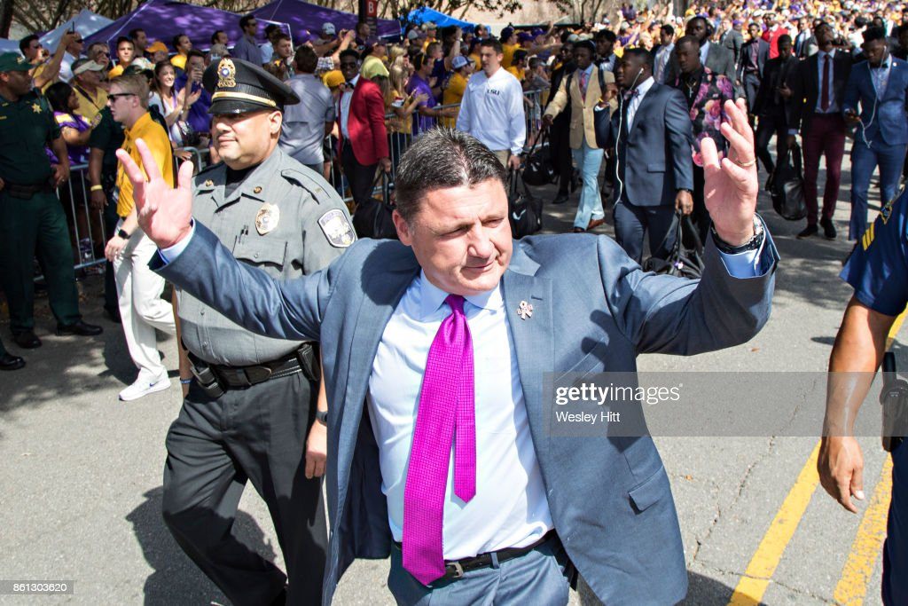 Head Coach Ed Orgeron of the LSU Tigers greets fans during the walk into the stadium before a game against the Auburn Tigers at Tiger Stadium on October 14, 2017 in Baton Rouge, Louisiana.
