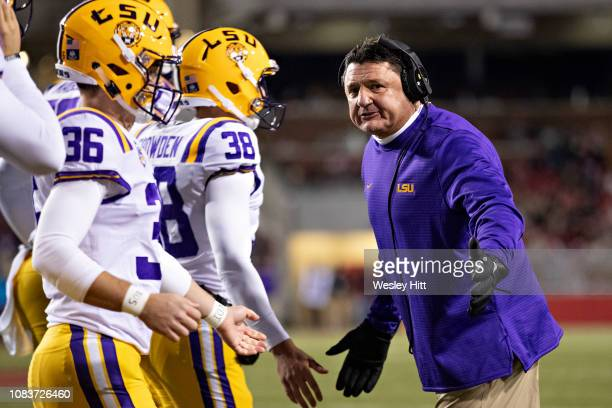 Head Coach Ed Orgeron of the LSU Tigers greets players coming off the field during a game against the Arkansas Razorbacks at Razorback Stadium on...