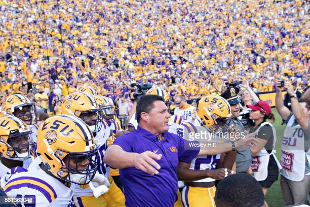 Head Coach Ed Orgeron of the LSU Tigers leads his team onto the field before a game against the Auburn Tigers at Tiger Stadium on October 14 2017 in...
