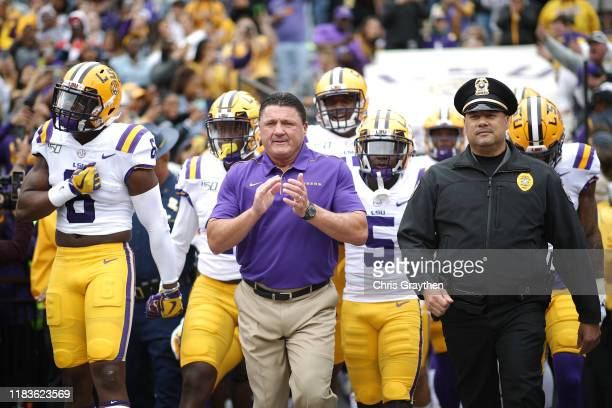 Head coach Ed Orgeron of the LSU Tigers leads the team on to the field against the Auburn Tigers prior to the game at Tiger Stadium on October 26...