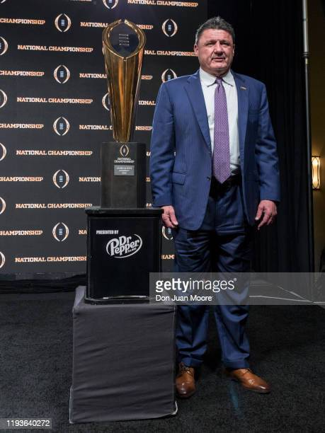 Head Coach Ed Orgeron of the LSU Tigers poses with the College Football Playoff National Championship Trophy after the press conference at the Grand...
