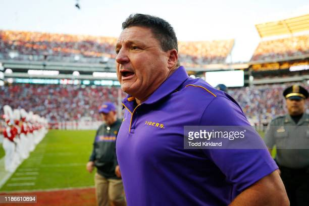 Head coach Ed Orgeron of the LSU Tigers runs to the locker room after the first half against the Alabama Crimson Tide in the game at BryantDenny...