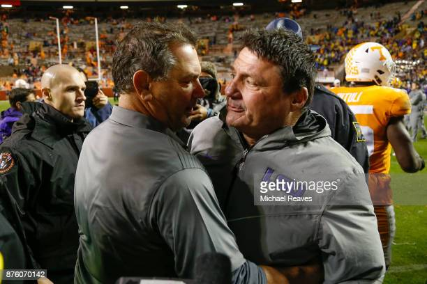 Head coach Ed Orgeron of the LSU Tigers shakes hands with interim head coach Brady Hoke of the Tennessee Volunteers after the game at Neyland Stadium...