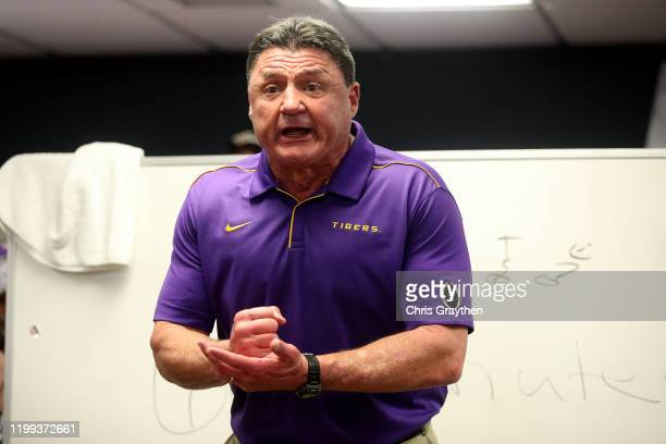 Head coach Ed Orgeron of the LSU Tigers talks to his team in the locker room after their 42-25 win over Clemson Tigers in the College Football...