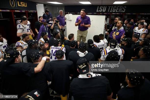 Head coach Ed Orgeron of the LSU Tigers talks to his team in the locker room after their 4225 win over Clemson Tigers in the College Football Playoff...