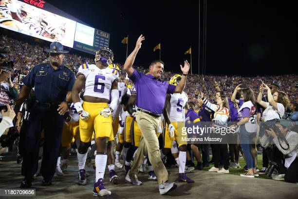 Head coach Ed Orgeron of the LSU Tigers walks onto the field during the first quarter against the Florida Gators at Tiger Stadium on October 12 2019...
