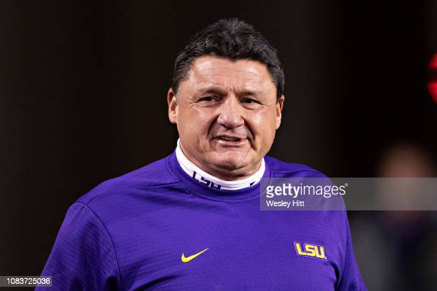 Head Coach Ed Orgeron of the LSU Tigers watches his team warm up before a game against the Arkansas Razorbacks at Razorback Stadium on November 10...