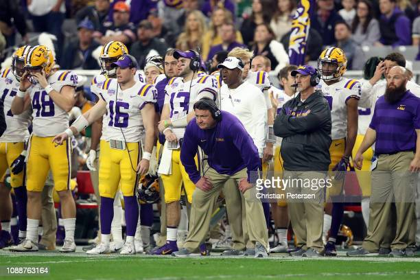 Head coach Ed Orgeron of the LSU Tigers watches the action during the second quarter of the PlayStation Fiesta Bowl between LSU and Central Florida...