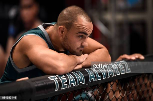 Head coach Eddie Alvarez watches as Barb Honchak enters the Octagon before facing Gillian Robertson during the filming of The Ultimate Fighter A New...