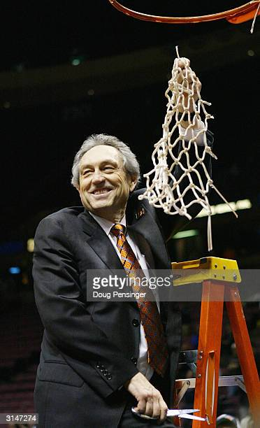 Head coach Eddie Sutton of the Oklahoma State Cowboys celebrates by cutting down the net after defeating the St Joseph's Hawks 6462 during their...