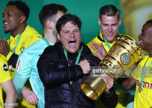 Head coach Edin Terzic of Borussia Dortmund celebrates with the trophy after winning the DFB Cup final match between RB Leipzig and Borussia Dortmund...