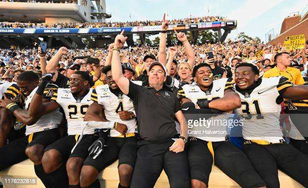 Head coach Eliah Drinkwitz of the Appalachian State Mountaineers celebrates with his players and their fans after a win against the North Carolina...