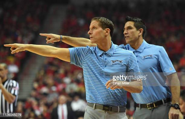 Head coach Eric Musselman and assistant coach Gus Argenal of the Nevada Wolf Pack gesture to their players during their game against the UNLV Rebels...