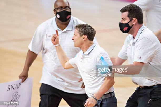 Head Coach Eric Musselman of the Arkansas Razorbacks is hit with two technical fouls and thrown out of the game during the second half of a game...