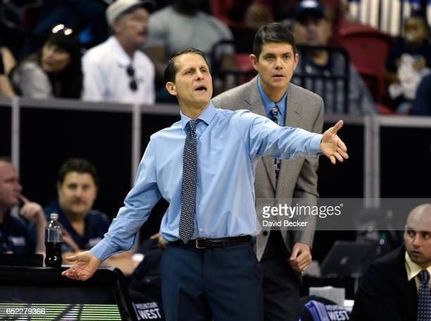 Head coach Eric Musselman of the Nevada Wolf Pack calls out as assistant coach Dave Rice looks on during the second half of the championship game...