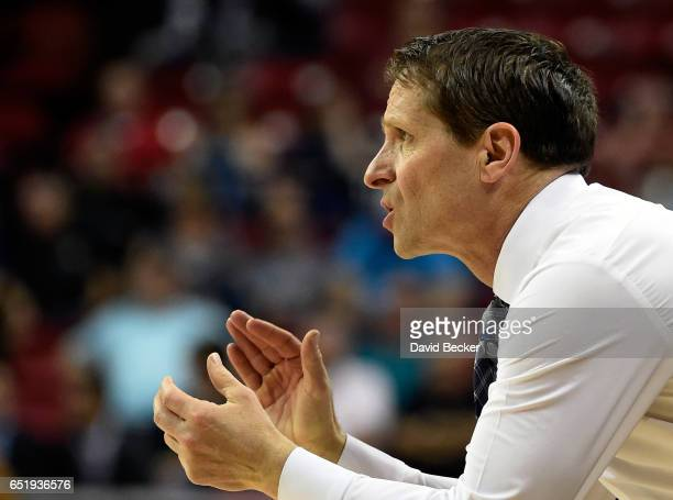 Head coach Eric Musselman of the Nevada Wolf Pack calls to his team during the second half of a semifinal game against the Fresno State Bulldogs of...