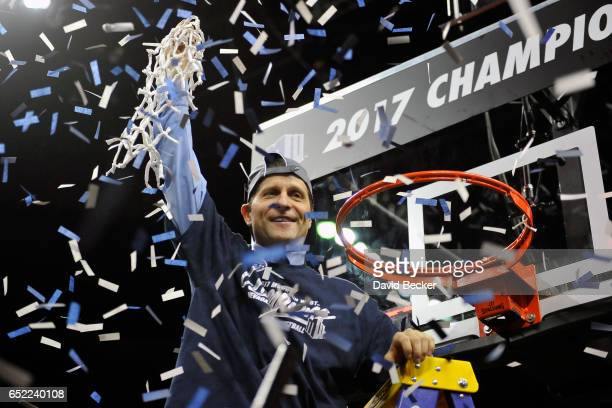 Head coach Eric Musselman of the Nevada Wolf Pack celebrates his team's victory over the Colorado State Rams in the championship game of the Mountain...