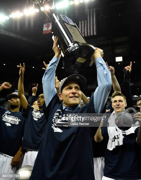 Head coach Eric Musselman of the Nevada Wolf Pack celebrates his team's victory with the championship trophy over the Colorado State Rams in the...