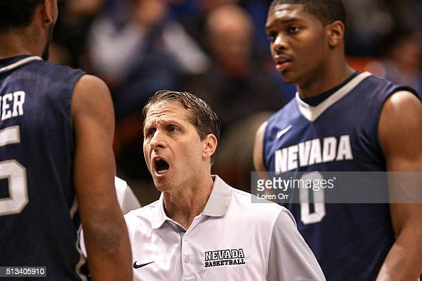 Head coach Eric Musselman of the Nevada Wolf Pack coaches up his player guard D J Fenner during first half action against the Boise State Broncos on...