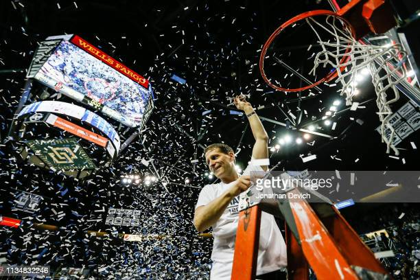 Head coach Eric Musselman of the Nevada Wolf Pack cuts a piece off of the net after beating the San Diego State Aztecs 8153 and clinching the...