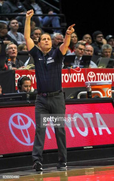 Head coach Eric Musselman of the Nevada Wolf Pack directs his players from the bench area during the first half against the San Diego State Aztecs at...