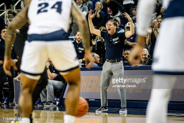 Head coach Eric Musselman of the Nevada Wolf Pack gets the crowd going when the San Diego State Aztecs gets the ball during the game between the...