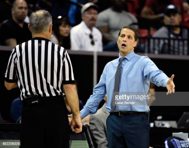 Head coach Eric Musselman of the Nevada Wolf Pack speaks with referee Randy McCall during the first half of the championship game against the...