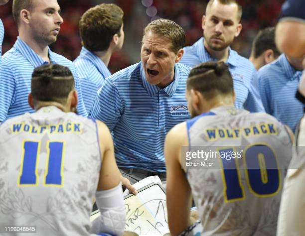 Head coach Eric Musselman of the Nevada Wolf Pack talks to his players during a timeout in their game against the UNLV Rebels at the Thomas Mack...