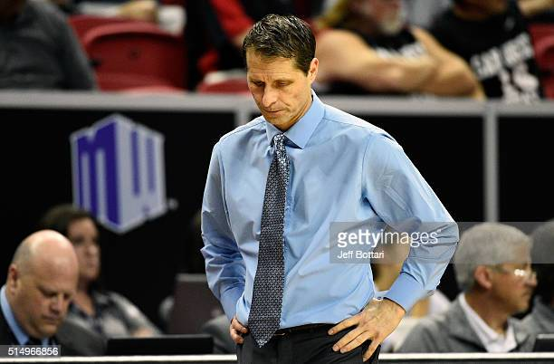 Head coach Eric Musselman of the Nevada Wolf Pack walks back to the bench against the San Diego State Aztecs during a semifinal game of the Mountain...