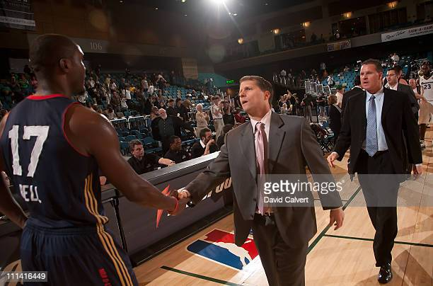 Head coach Eric Musselman of the Reno Bighorns shakes hands with D'Andre Bell of the Bakersfield Jam following the game April 1 2011 at the Reno...