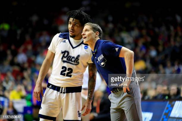 Head coach Eric Musselman speaks with Jazz Johnson of the Nevada Wolf Pack against the Florida Gators in the second half during the first round of...