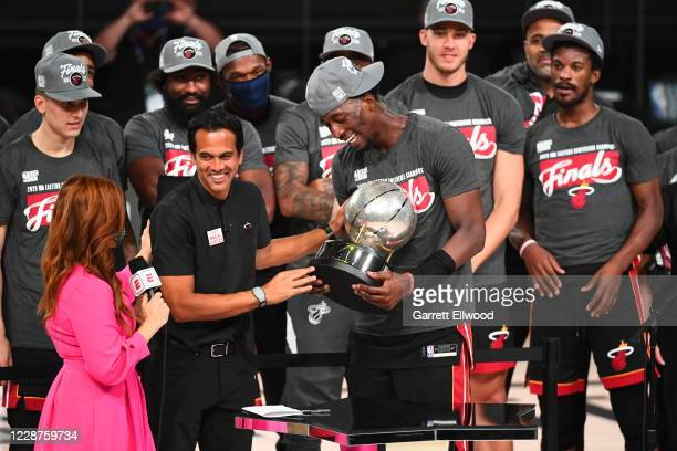 Head Coach Erik Spoelstra and Bam Adebayo of the Miami Heat hold the Western Conference Finals Trophy after winning Game Six of the Eastern...
