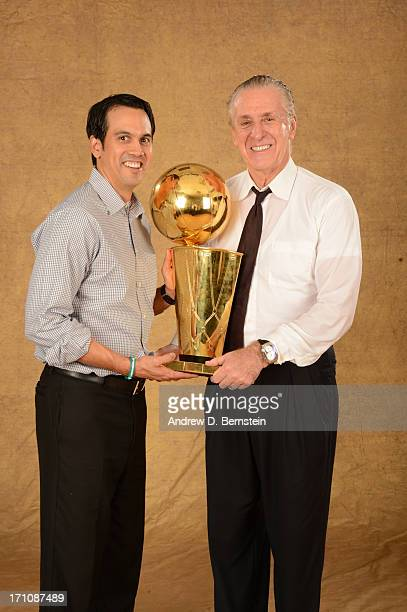 Head Coach Erik Spoelstra and President Pat Riley of the Miami Heat poses for a portrait with the Larry O'Brien Trophy after defeating the San...