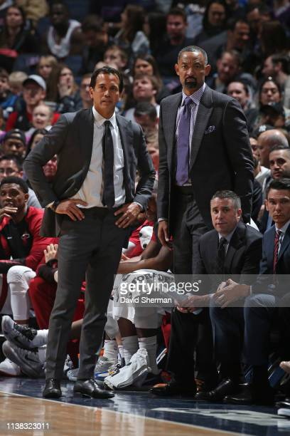 Head Coach Erik Spoelstra Assistant Coach Juwan Howard of the Miami Heat looks on against the Minnesota Timberwolves on April 5 2019 at Target Center...