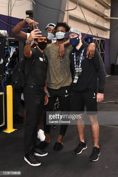 Head Coach Erik Spoelstra, Bam Adebayo, Jimmy Butler and Goran Dragic of the Miami Heat take a photo after winning Game Six of the Eastern Conference...