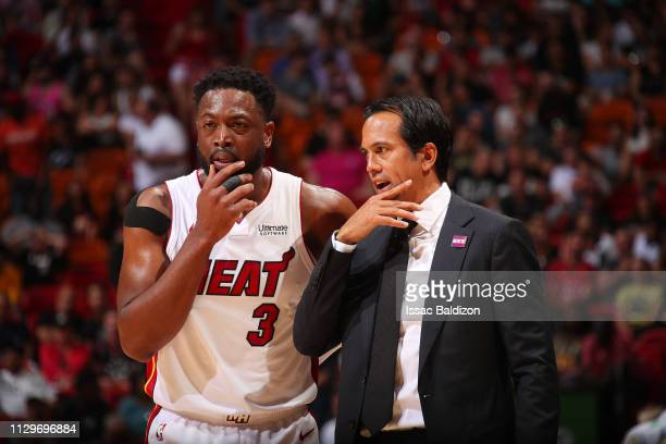 Head Coach Erik Spoelstra of the Miami Heat and Dwyane Wade react during the game against the Toronto Raptors on March 10 2019 at American Airlines...