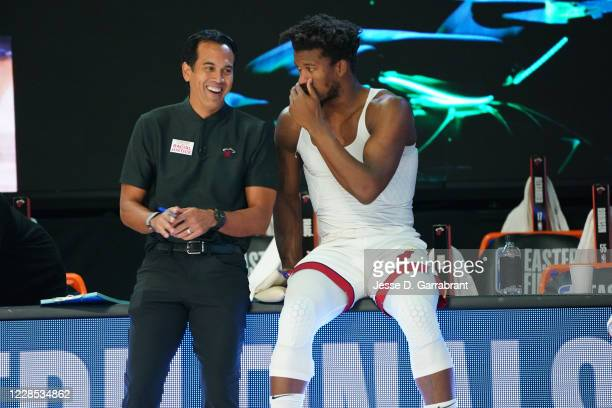 Head Coach Erik Spoelstra of the Miami Heat and Jimmy Butler of the Miami Heat talk prior to a game against the Boston Celtics before Game One of the...