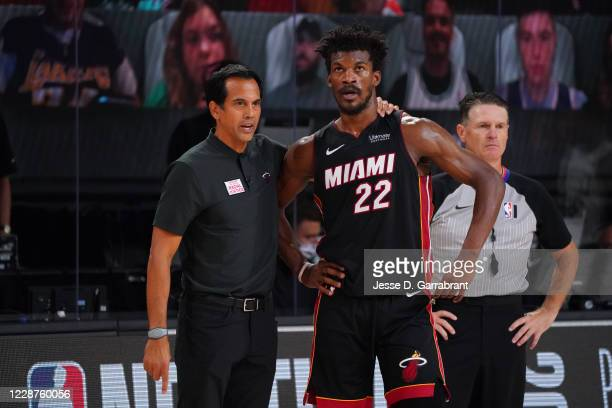 Head Coach Erik Spoelstra of the Miami Heat and Jimmy Butler of the Miami Heat talk during Game Six of the Eastern Conference Finals of the NBA...