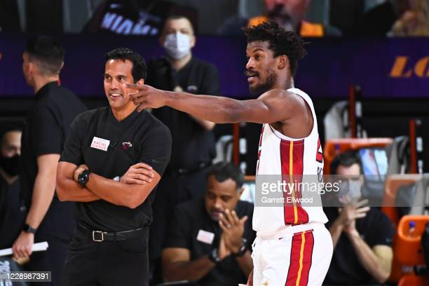 Head Coach Erik Spoelstra of the Miami Heat and Jimmy Butler of the Miami Heat talk during Game Five of the NBA Finals on October 9, 2020 at the...