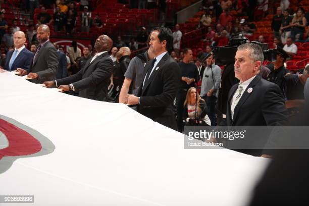 Head Coach Erik Spoelstra of the Miami Heat holds the Marjory Stoneman Douglas HS flag prior to the game against the Memphis Grizzlies on February 24...