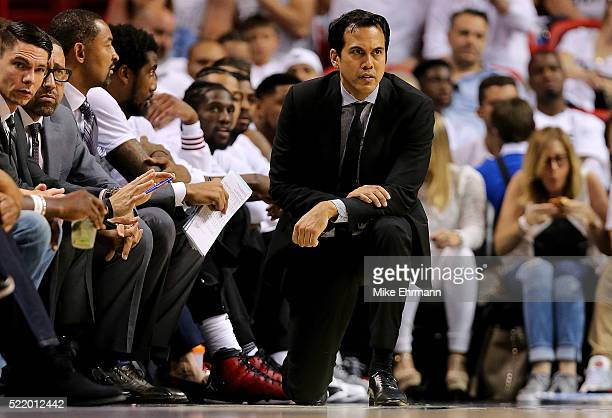 Head coach Erik Spoelstra of the Miami Heat looks on during Game One of the Eastern Conference Quarterfinals against the Charlotte Hornets during the...