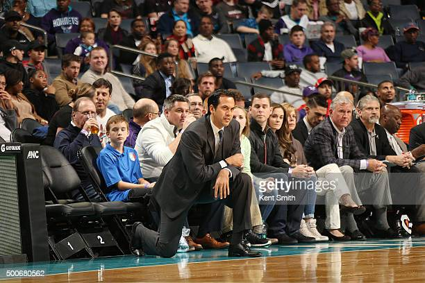 Head coach Erik Spoelstra of the Miami Heat looks on during the game against the Charlotte Hornets on December 9 2015 at Time Warner Cable Arena in...