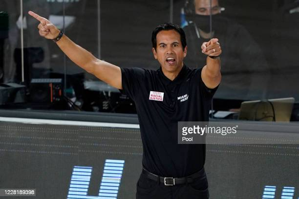 Head coach Erik Spoelstra of the Miami Heat motions toward the court during the second half during the second half of a first round playoff game...